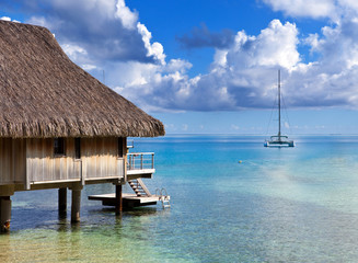 Catamaran and wooden hut at the sea.