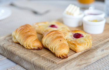 breakfast with croissants on wooden tray, selective focus