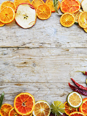 Dried fruits and spices on wooden background