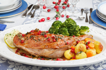 Christmas dish roasted turkey leg with gooseberries