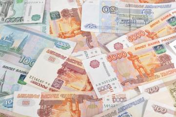 Деньги, купюры раскиданные по столу, фон