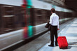 Leinwanddruck Bild - businessman at the train station