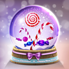 Snow glass crystal ball with christmas lollipops and candycanes