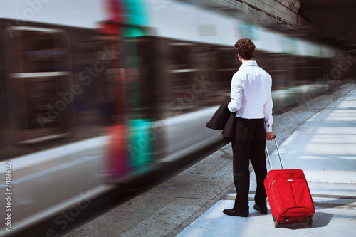 businessman at the train station - 74036127