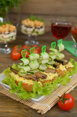 Sandwiches with sprat, egg and cucumber