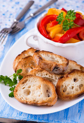 Toasted crusty baguette with roasted peppers