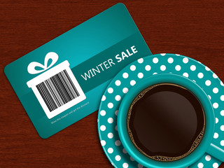 cup of coffee with winter sale coupon on table