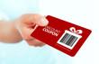 Leinwanddruck Bild - red christmas coupon holded by hand over white