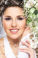 Young and beautiful bride with a flower bouquet