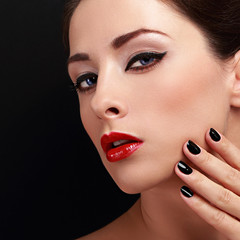 Makeup woman with red lips and black nails polish