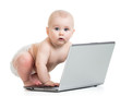 funny baby playing on laptop