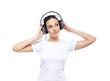 Teenage girl listening to the music in headphones