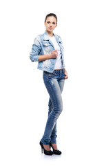 Teenage girl in denim jeans isolated on whit