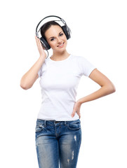 Young and pretty teenage girl listening to the music isolated on