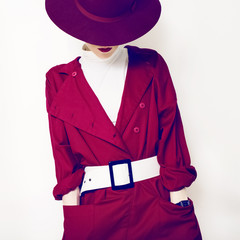 beautiful vintage lady fashionable style in a red cloak and hat