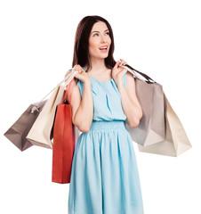 Beautiful young woman carrying shopping bags
