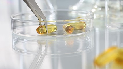 vitamins supplements pills omega 3 on table