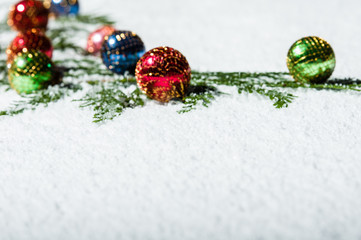 Group of Christmas ornaments in the snow