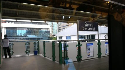 Thailand, Bangkok, 1 August 2014. Looking out the window of