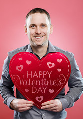 Happy man with a Valentine's Day heart