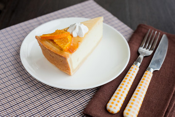 Cheesecake Dessert decorated with oranges and meringue