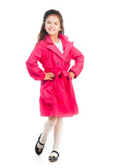 little girl in a pink raincoat