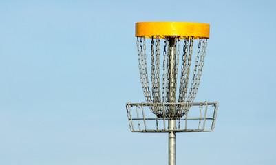 Frisbee golf basket against blue sky