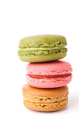 Tasty colorful macaroon bite on white background