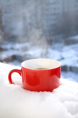 Red Tea Cup In Snow in Morning Winter Mood Christmas