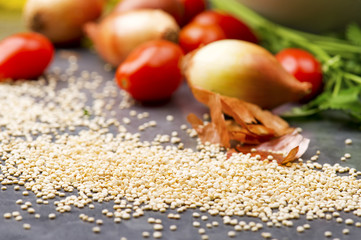 Close up of quinoa grains cherry tomato, onion and parsley