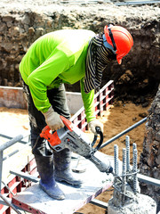 Portarait of positive Builder worker with pneumatic hammer drill