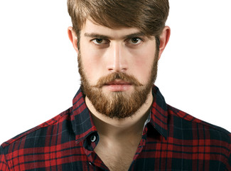 Portrait of Serious Bearded young man on a white background