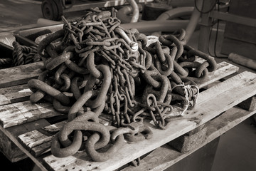 chain rusted at small fish-harbour