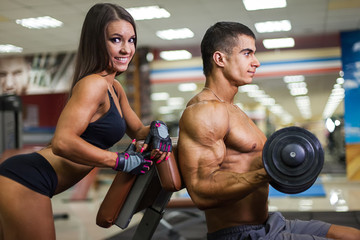 Couple assist in weighting each other