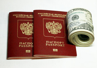Russian Passport And Dollars USA Isolated On White Background