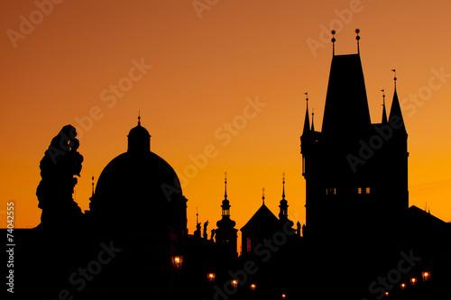 Staande foto Praag The silhouettes of towers and statues on Charles Bridge in Pragu