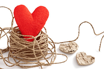 Valentine's Day. Red heart in nest with hearts from  bark