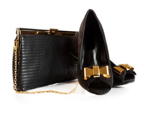 Black female leather bag and velvet shoes on white background
