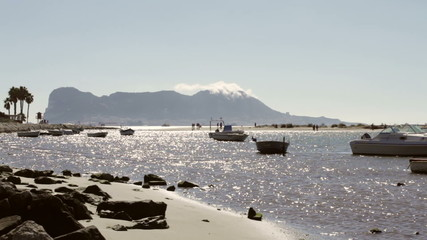 The Rock of Gibraltar and seaside in Palmones, Spain.