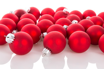 Red Christmas balls isolated at a white background