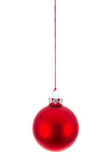 Red Christmas ball hanging at a rope over white