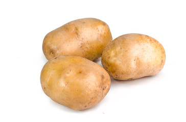 Pink Potato tubers on white background