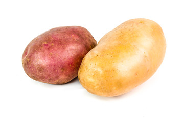 Two red and white potatoes