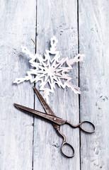 Handmade paper snowflake and vintage scissors