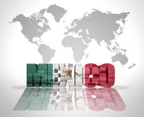 Word Mexico on a world map background