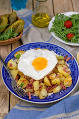 Roasted potatoes with bacon and eggs