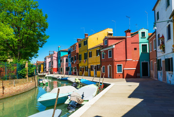 Canal and colorful buildings in Burano island, Venice, Italy