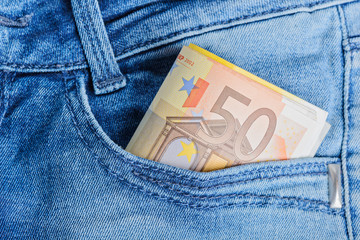 Euro banknotes in a pocket
