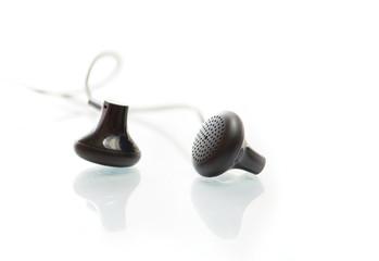 Black earphones on white background