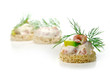 Leinwanddruck Bild - canapes with shrimp cocktail, avocado and  dill garnish, isolate